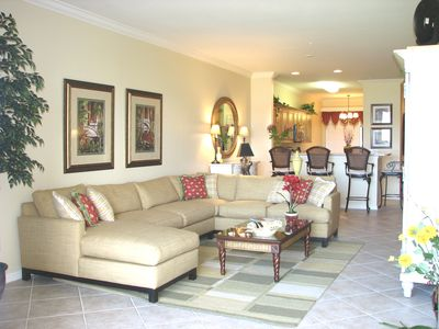 Family room with large sectional and open floor plan