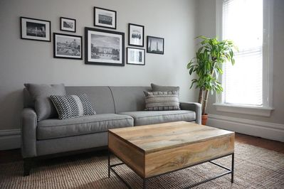 Relax in our serene living room with multiple cozy seating options.