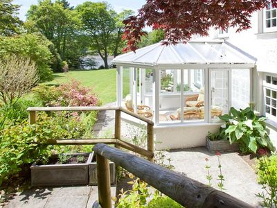 Photo for Detached holiday home with large garden and lovely conservatory by the Lerryn river