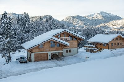 The front of the chalet in Winter with Mont Chery in the background
