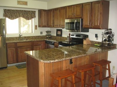 There's a fully-equipped kitchen with a washer/dryer in attached laundry room.