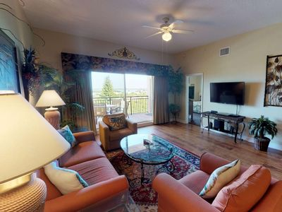 Photo for Top Floor Overlooking the Marina. Close to Johns Pass. Spacious with Two Private Balconies!