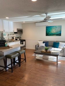 Photo for Private Patio 1br/1ba, steps to the beach! A/C, kid/pet friendly w/ parking.