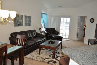 Large living room with comfortable furniture and TV