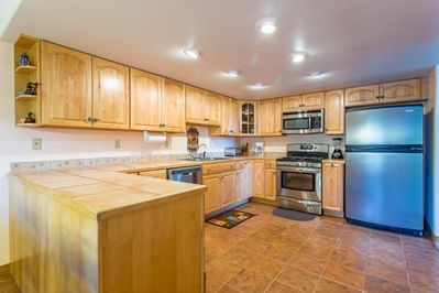 Spacious modern kitchen with updated stainless steel appliances