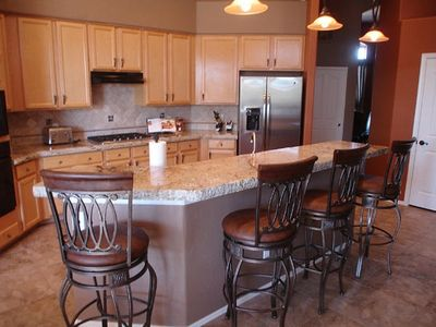 New Granite counters, New cook top, microwave and refrigerator