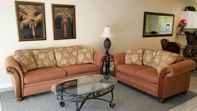 "Photo for 1st floor by pool & gym.  Great location..  55"" TV in LR."