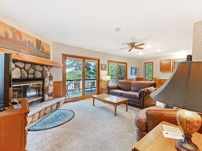 Photo for Waterfront villa w/ fireplace, deck & shared tennis/game room - dogs welcome!