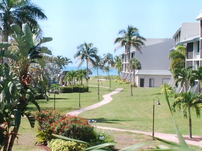 Photo for World class beach outside your condo.  Easy walk or bike to town.