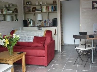 Photo for Ground floor apartment with terrace in Courseulles / Sea near sea, tastefully decorated.