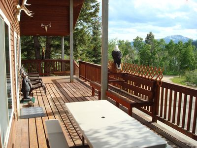 You'll enjoy panoramic mountain views while relaxing on the wrap around deck.
