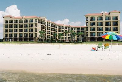 View of condos from beach. Beach towels, chairs, & umbrellas provided.
