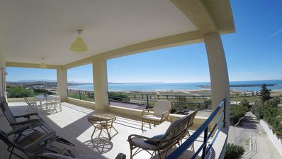 Photo for A few steps from the beach of Porto Palo, apartment in a villa with sea view