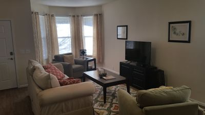 Living room with bay window and smart TV & high speed wireless Internet