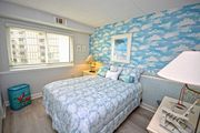 Lush, spacious 2 bedroom oceanfront condo with WiFi, an indoor pool, a game room, and great view of ocean located in exciting uptown and just steps to the beach!