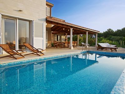 Photo for Exclusive villa with heated infinity pool, seaview terraces & direct beach access