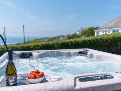 Photo for Stylish and spacious dog friendly Woolacombe cottage, with hot tub and close to the beach.