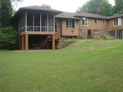 View of screened porch and covered patio