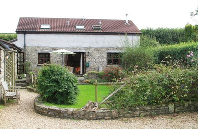 Photo for A beautiful converted barn in Georgeham, with hot tub, 1.5 miles from surf beach