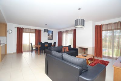 Double Apect Lounge/dinning room with views onto pool & rear  & side garden