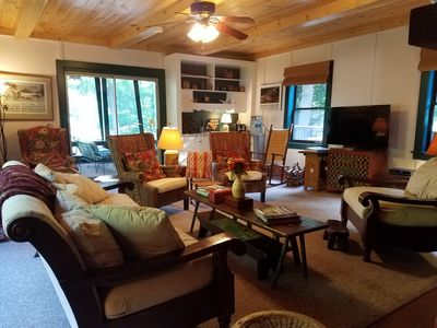 Lodge style living room with all new flooring throughout entire first floor