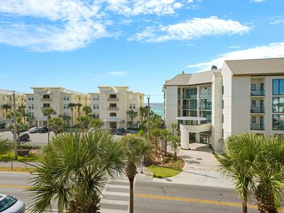 Photo for Spacious condo w/ large living area, private balcony & shared pool!