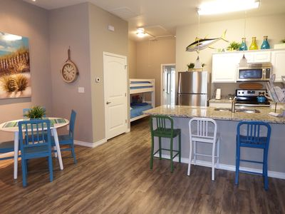 Open floor plan seating for 7 and small table and chairs for kids (not pictured)