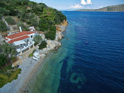 Tyhe beach with sunbeds and umbrella , Kayak along the coves to explore