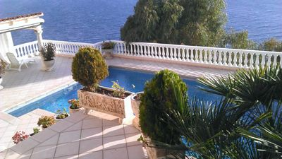 Photo for Roses: apartment sleeps 2/4 with pool and sea view in private garden