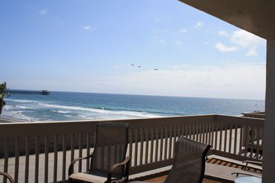 Large upper level balcony can accommodate 10+ people. Pelicans fly by daily. GJT