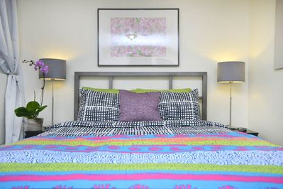 Queen-size bed with dramatic steel bed frame