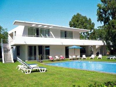 Photo for This 3-bedroom villa for up to 6 guests is located in Portimao and has a private swimming pool, air-