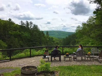 Sit outside, chatting with friends while enjoying uspoiled mountain views.