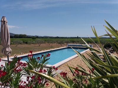 Photo for Charming cottage ground garden renovated in provencal farmhouse, swimming pool 14m, Vaucluse