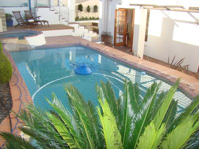 Solar heated pool and jacuzzi (both with safety net)