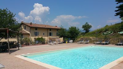 Photo for 7 bedroom Villa, sleeps 18 with Pool, FREE WiFi and Walk to Shops