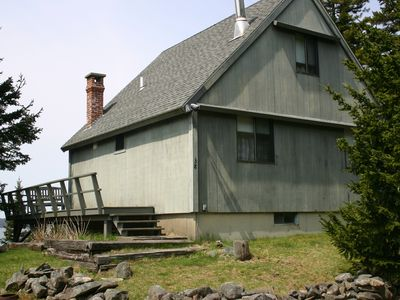 Photo for Secluded summer cottage on 11 private waterfront acres