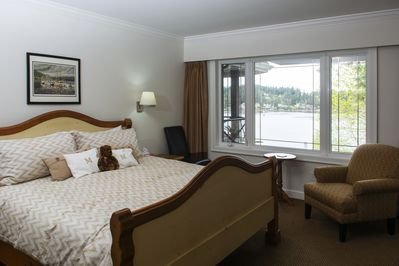 Master bedroom with gas fireplace and water view