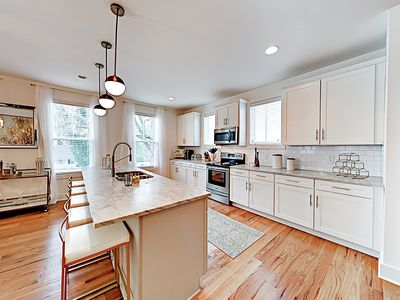 Kitchen - The gourmet kitchen is outfitted with marble countertops and a full suite of stainless steel appliances.