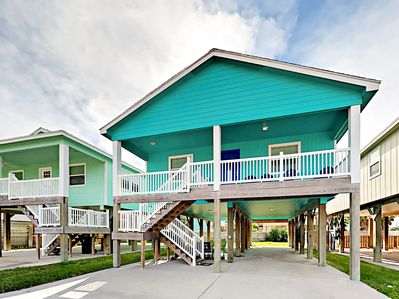 Exterior - Embrace the sea breeze on the deck at this beautiful raised home.