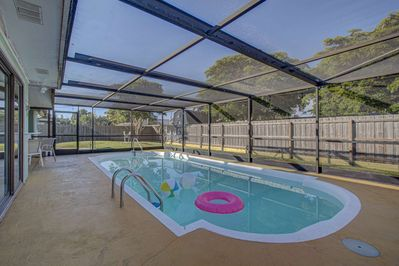 Large private swimming pool screened in to keep bugs and critters out!