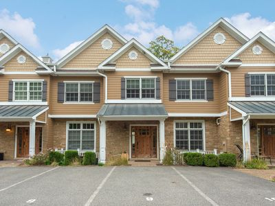 Photo for Lake front town home in central Deep creek w/ hot tub & private dock!