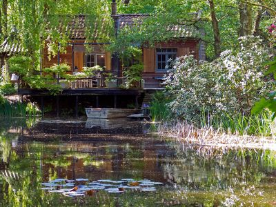 Photo for Cosy chalet on private grounds surrounded by forests with private pond