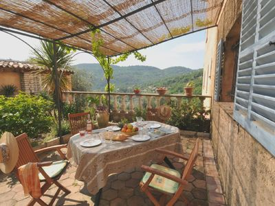 Photo for Upper Garden Apartment with ***Large Heated Pool***