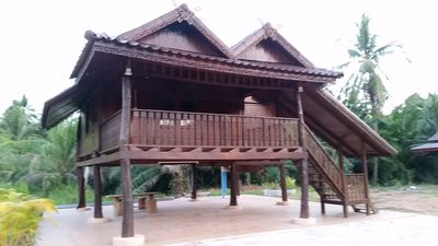 Photo for Thai style teak house in the green river in a tropical orchard