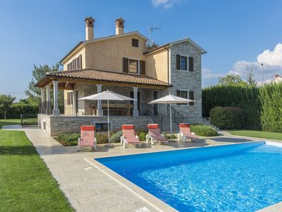 Photo for Modern villa with private pool and beautiful garden 25 km from Rovinj