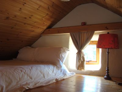 Loft bedroom with comfortable bed