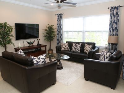 Photo for Sunny Gated Condo - across Coconut Point Mall - Steps from Resort Pool/Spa/Gym