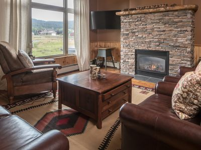 Photo for Modern condo with mountain views and easy access to the town center
