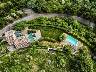 A birdseye view of Villa Rosa, a private home nestled into the Tuscan hillside